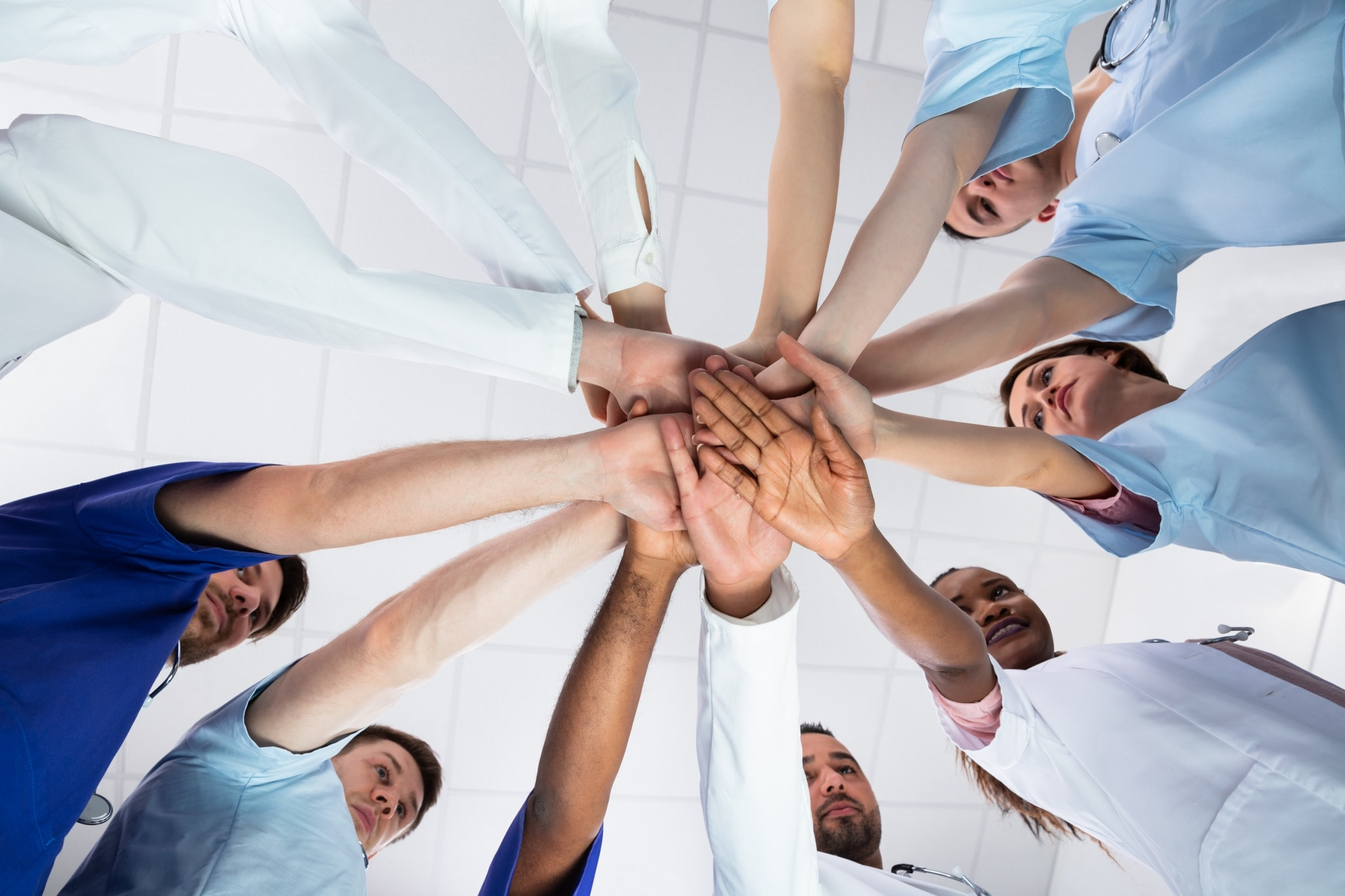 Healthcare team touching hands