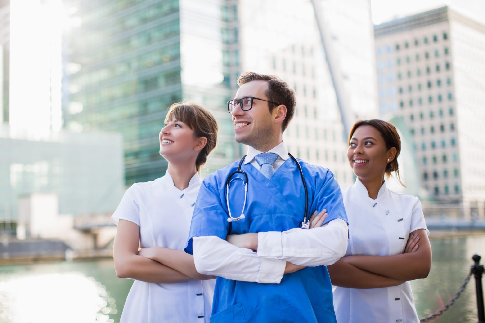 A team of nurses standing outside